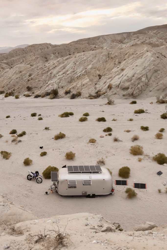 Airstream camped in the desert with solar panels
